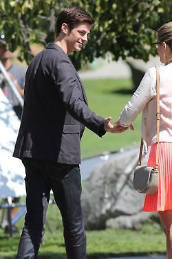 """""""The Flash"""" shoots episode 4 in downtown Vancouver, Canada with an """"Arrow"""" crossover where Grant Gustin and Emily Bett Rickards meet at a park where Grant """"The Flash"""" Gustin tries to impress Emily's character Felicity Smoak and then taking her hand walking away into the sunset."""