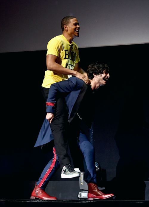 Ezra Miller and Ray Fisher onstage at CinemaCon 2017 Warner...