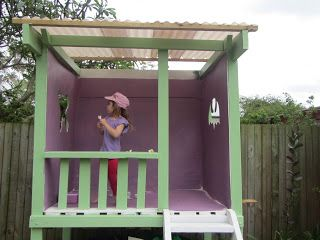 """From the """"Crafty little people"""" blog: Wooden painted cubby house made of pallets for the base, left over wood and sheets of plywood."""