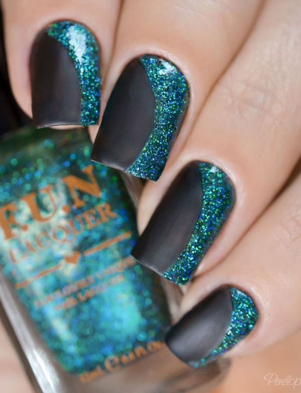 Black, blue and green glitter nail art. Give life to that matte black nails of yours by adding a half moon of blue and green glitter polish on top.