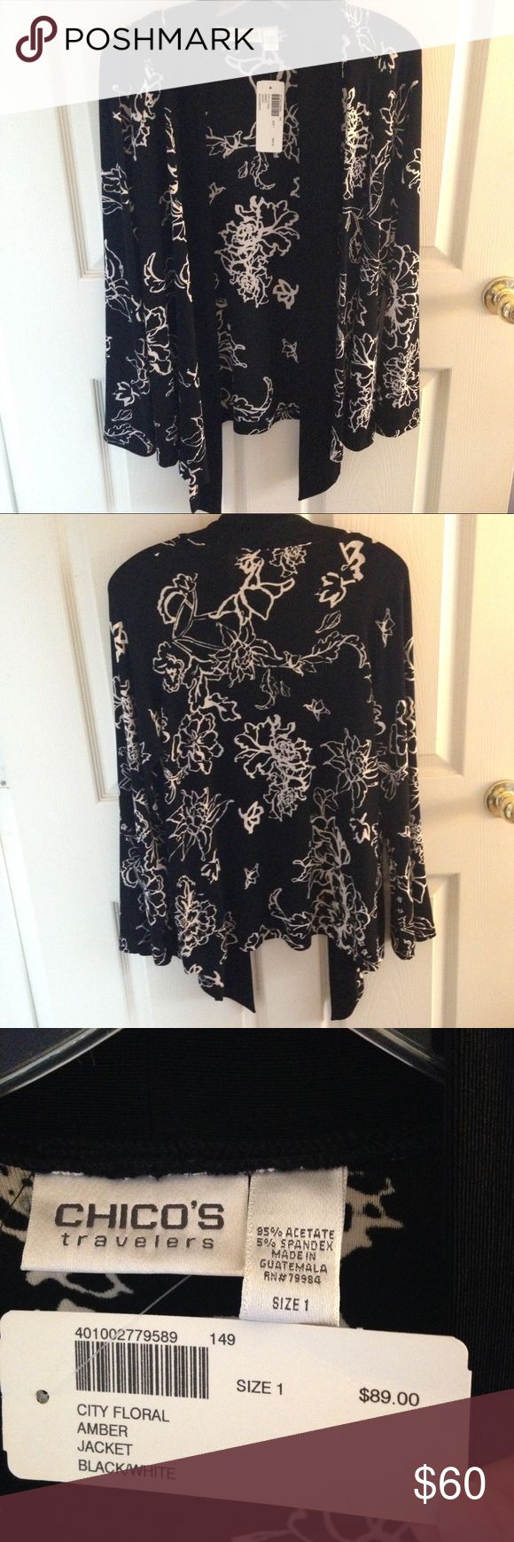 Chico's Travelers Cardigan, Size 1 - Med 💢NWT💢 This BRAND NEW W/ TAGS Chico's black & white floral cardigan in the Travelers line does not wrinkle!  Can get a lot of wear out of this at the office, out to dinner, and on vacation.  Chicos size 1 is equivalent to a size medium.  (Pet-free and Smoke-free home.)  🌹 Chico's Sweaters Cardigans