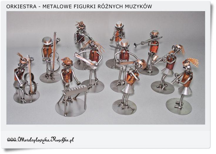 Figurki przedstawiające różnych muzyków jako upominek dla absolwenta Szkoły Muzycznej