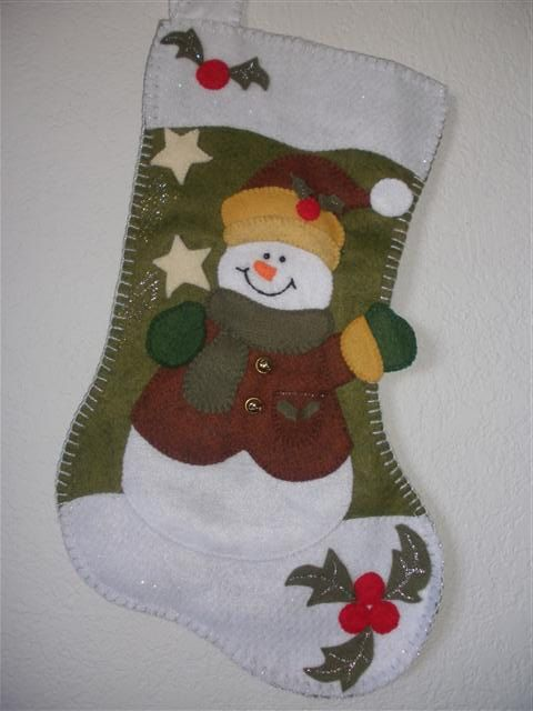 christmas  felt snowman stocking set of two (girl and boy). $70.00, via Etsy.