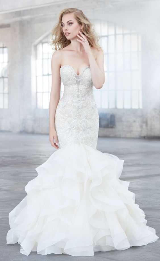 Featured Dress: Madison James; Wedding dress idea.