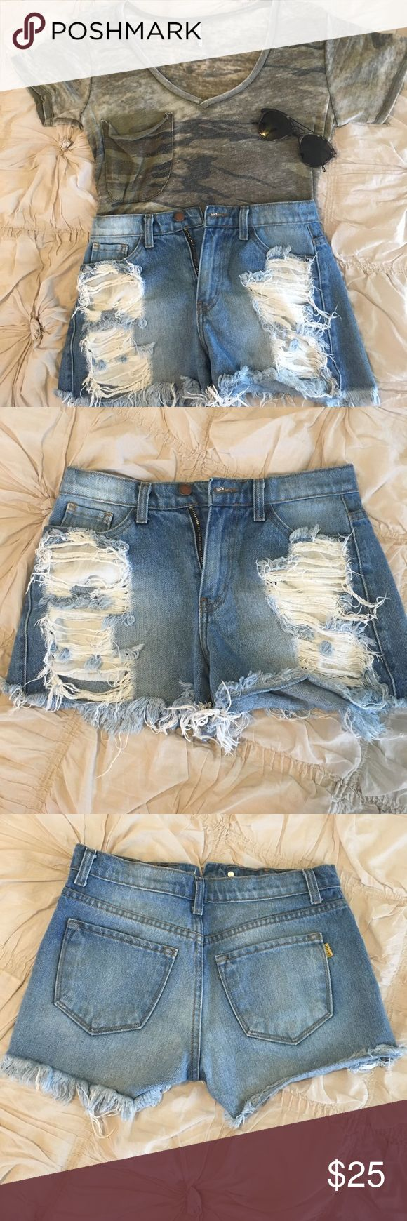 High Waisted Shorts Super distressed high waisted shorts! So adorable! From Apricot Lane Peoria. Size Small. In perfect condition. Vibrant Shorts Jean Shorts