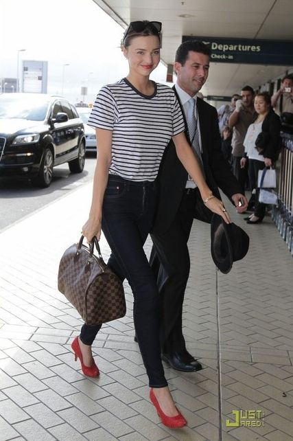 Miranda Kerr wearing Flint Hasta Luego Sunglasses, Maison Martin Margiela Paillette-Embellished Peep-Toe Pumps, Louis Vuitton Damier Speedy 30, Bassike Navy and White Striped Linen Tee and Nobody Cult Skinny Jeans in Addict.
