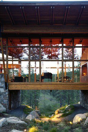 Ridge House, Tom Kundig - Eastern Washington, 2001 | This house is constructed of wood boxes atop of three stone piers in a forest. The areas of the house are open and interconnected with each other.