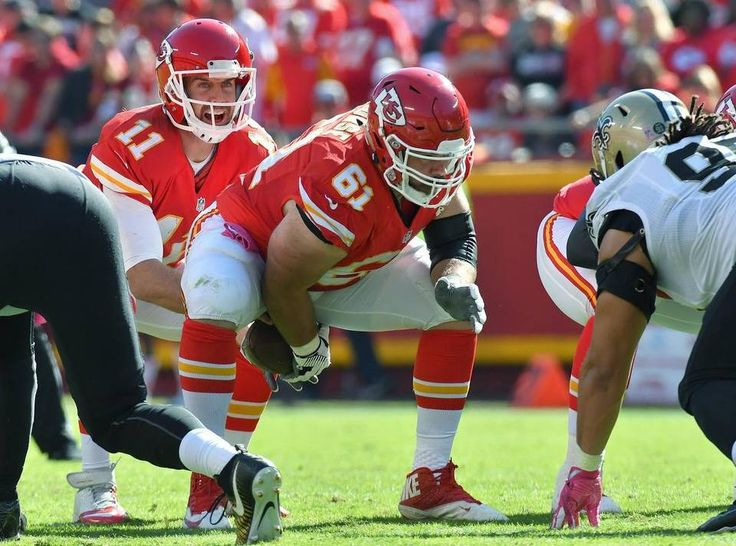 Saints vs. Chiefs  -  27-21, Chiefs  -  October 23, 2016:    Kansas City Chiefs quarterback Alex Smith takes the snap from center Mitch Morse in the third quarter during Sunday's football game against the New Orleans Saints on October 23, 2016 at Arrowhead Stadium in Kansas City, Mo.