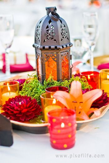 Lantern and flowers creates a simple yet magical centrepiece | The Maharani Diaries...this is a lovely diwali decor idea!!