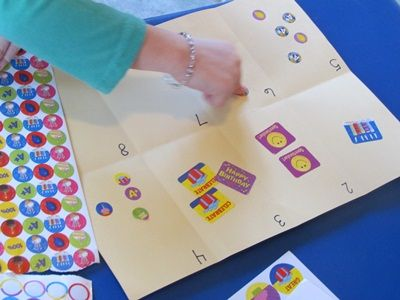 Fold paper into 8 sections, label each with a number.  Count out and match number of stickers.