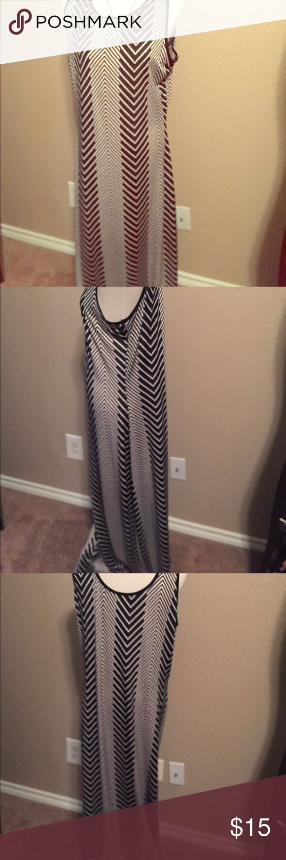 Black/ white maxi dress. Beautiful ladies maxi dress by Just Love. Size Large. Nice pattern print. Split along right bottom side for that sexy look. just love Dresses Maxi