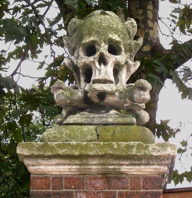 The Skull and Crossbones of St. Nicholas Church, Deptford by David Lunn, via Geograph