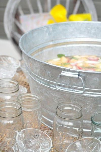 Shower punch served in a galvanized tub for a fun, casual look.  See more bridal shower punch and party ideas at www.one-stop-party-ideas.com