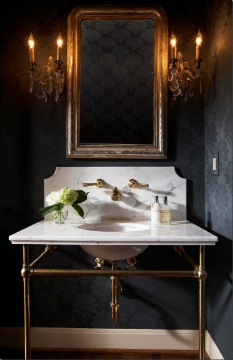 Dark Drama: Black & Gold. Powder room with white marble sink and black damask wall paper and crystal sconces