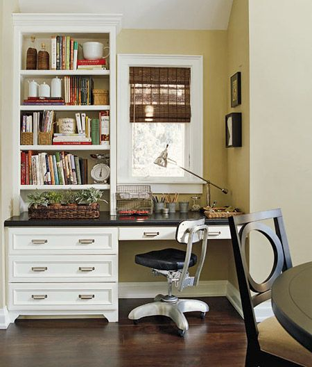 Home Office Niche  Built-in home office furniture turns a former dining niche into a sleek, space-saving desk area. A window offers natural light for everyday tasks such as copying recipes or writing grocery lists. The cabinets match those found in the rest of the kitchen for a seamless look.