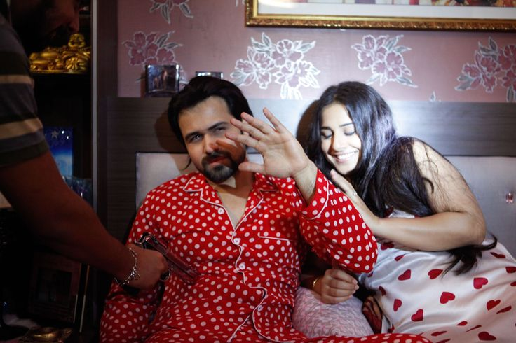 Actors love flashbulbs don't they? Then why is Emraan cringing here? Any idea?