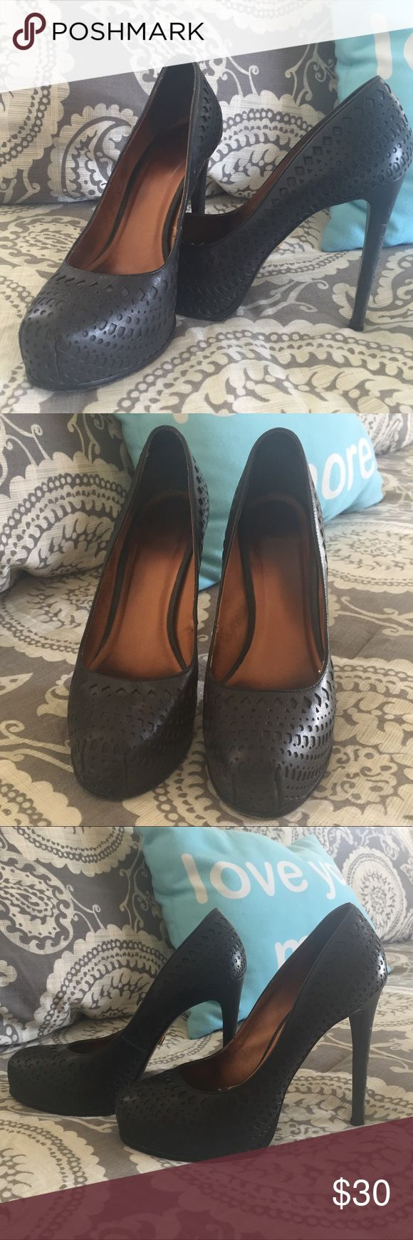 """🆕 Pour La Victoire Pumps Beautiful Pour La Victoire patterned black leather pumps!!  These have had a bit of wear, but have many more miles to go. I absolutely love these shoes, but my foot grew a little bit after baby and I just can't squeeze my foot in anymore 😫  They definitely need a new home!!   5"""" heel 1.25"""" covered platform   See second to last photo for wear Last photo is stock photo to show fit.   Open to reasonable offers No Trades Pour la Victoire Shoes Platforms"""