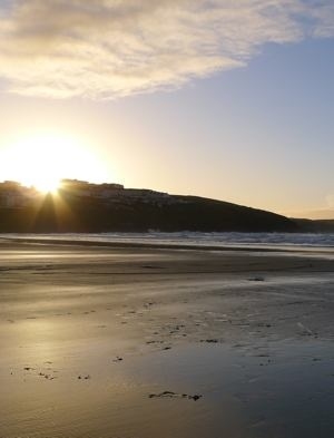 Winter sun setting on Fistral Beach.