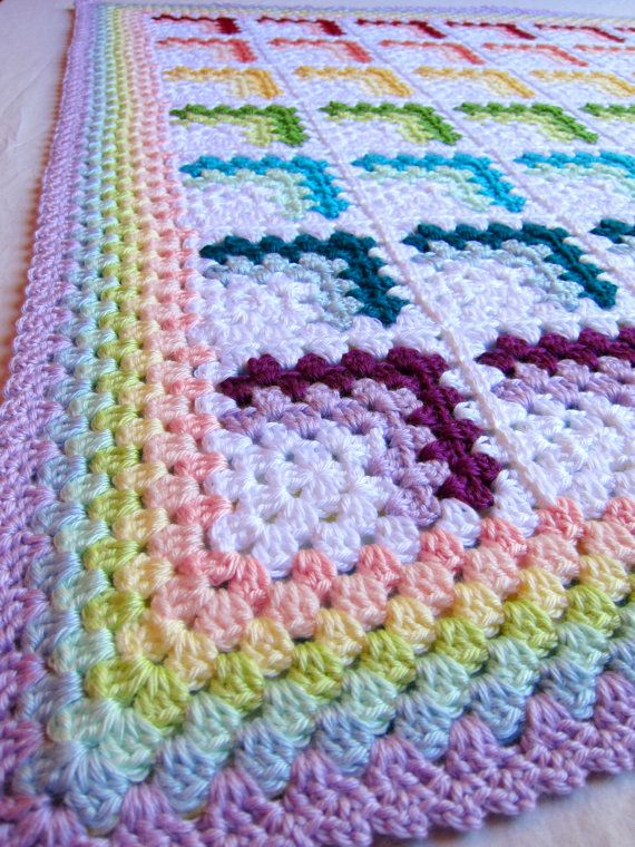 made to order. this bright and soft pastel rainbow baby blanket will definitely stand out in the crowd! rainbows are gender neutral and are perfect for both baby girls and baby boys! it is made with super soft medium worsted weight acrylic yarn in 15 different colors. it is extremely versatile and so warm! great for newborn babies, cribs, and photo props. made in my pet and smoke free home.    34 x 40    custom made afghans can take up to 2 weeks to make. if you would like a large size or…