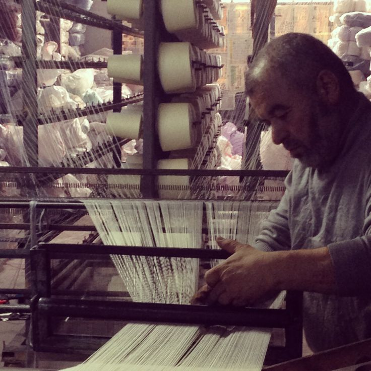 Mr. Mehmet making a 'cozgu' (a roll of warp threads) for the loom