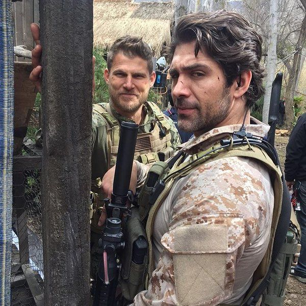 Wolf Taylor (Bren Foster) and Danny Green (Travis Van Winkle) on set of The Last Ship season three