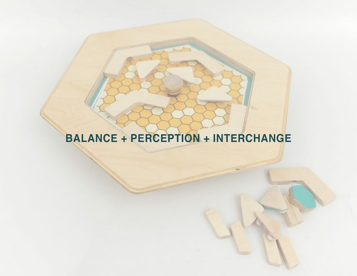 HEXi by Ali Alamzadeh and Andyi Liao introduces an interactive balancing labyrinth with customizable graphical game boards that can be interchanged, and magnetic pieces that can be placed at any desired location. #hexi#game#marble#design#industrial#balticbirch#birch#leather#andyi#liao#ali#alamzadeh#kids#magnets