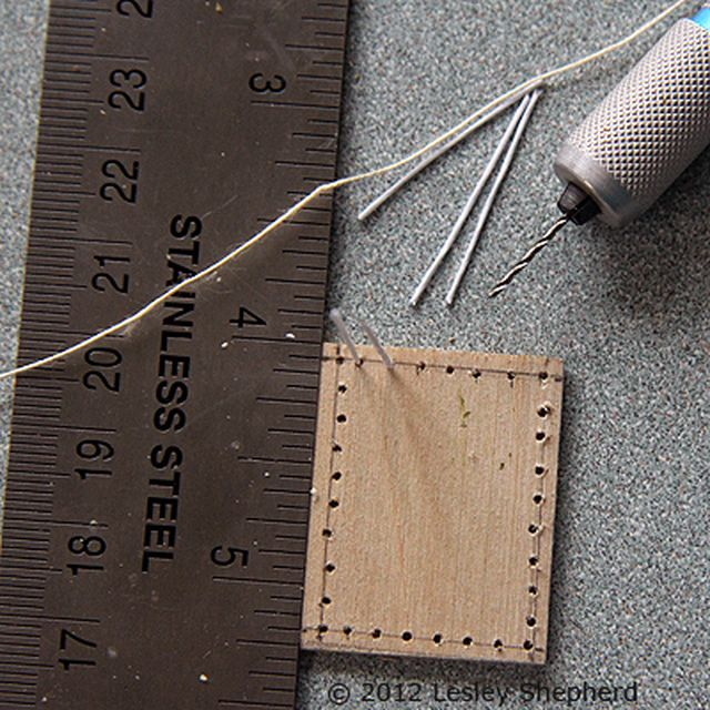 Drilling the holes on the wooden base of a dollhouse miniature pastry basket - Photo © 2012 Lesley Shepherd