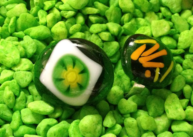 Locally made (Cairns, Australia) from recycled glass.  These rings come in a range of colours with an adjustable band.