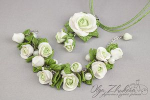 http://polyflowers.deviantart.com/art/Bracelet-with-white-roses-from-polymer-clay-414598175
