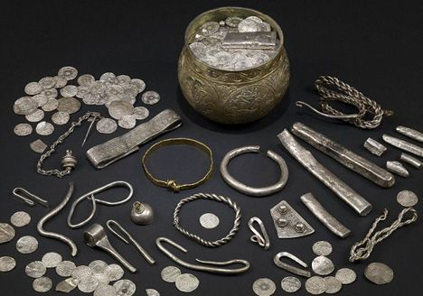 An undated handout picture released on August 27, 2009 shows some of the hundreds of items from a Viking hoard of jewels unearthed in England by a father-and-son team of treasure hunters in 2007. The Vale of York hoard, valued at 1.1 million pounds ($1.8 million) and dated at 1,000 years old, includes objects from Afghanistan, Ireland, Russia and Scandinavia, underlining the global spread of cultural contacts during medieval times.  The hoard, acquired by the York Museums Trust and the…