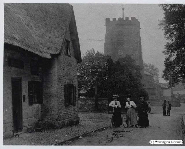 Grappenhall village- a beautiful cobbled road with St Wilfrids church in the background.