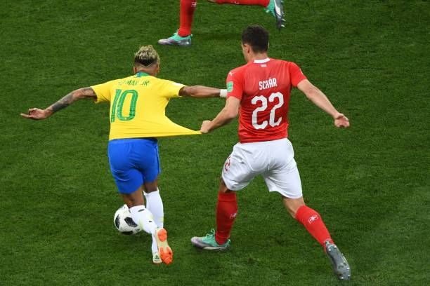 Topshot Switzerland S Defender Fabian Schaer Pulls The Jersey Of Brazil S Forward Neymar During The Russia 2018 World Cup Group Jersey Defender Football Match
