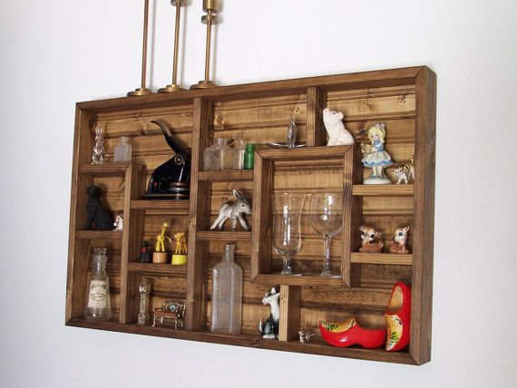 Display your knick knacks on these wood shadow box shelves. Perfect for displaying and organizing your small items. These unique wall shelves measure 20 inches tall, 32 Inches wide, and are 2 inches deep on the inside shelves (2 5/8 deep on the outside frame). See our other