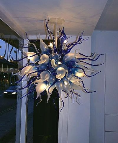 Blue and frosted blown glass light fixture with whimsical tails