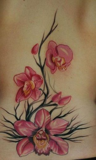 Orchids on black twigs tattoo