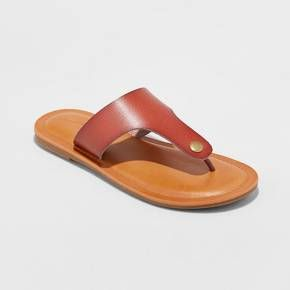 Get the perfect finishing touch to any warm-weather look with the Elberta Flip-Flop Sandals from Universal Thread™. In cognac brown, these stylish flip-flops will mix in easily with a variety of casual and dressy outfits. The wider strap provides you with extra support and comfort to go about your day with ease — great for long shopping trips, strolls in the city or fun date nights. Pair them with a cute shift dress on a breezy summer day, then switch to skinny jeans and a ...
