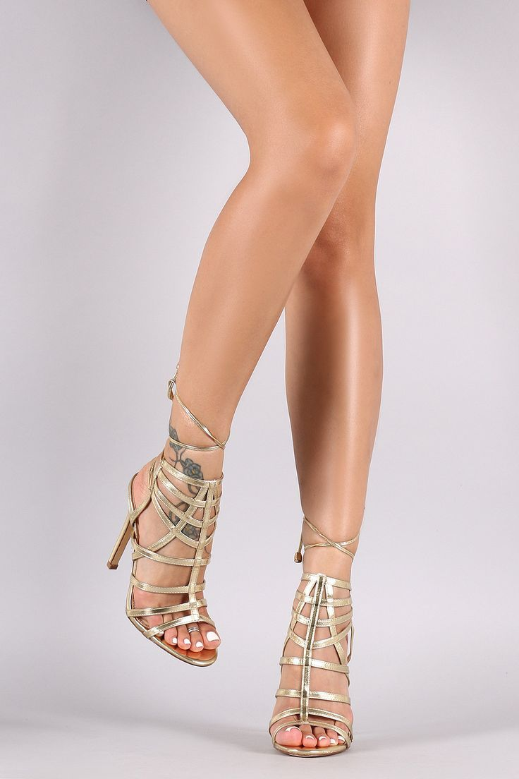 These striking heels feature a caged design vamp, open toe silhouette,  wrapped stiletto heel, and back lace-up closure. Finished with a lightly  padded ...