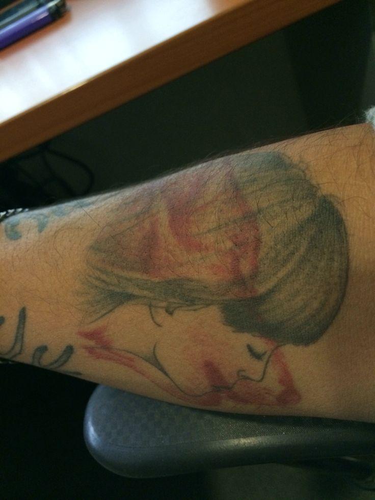 Wolf-woman tattoo