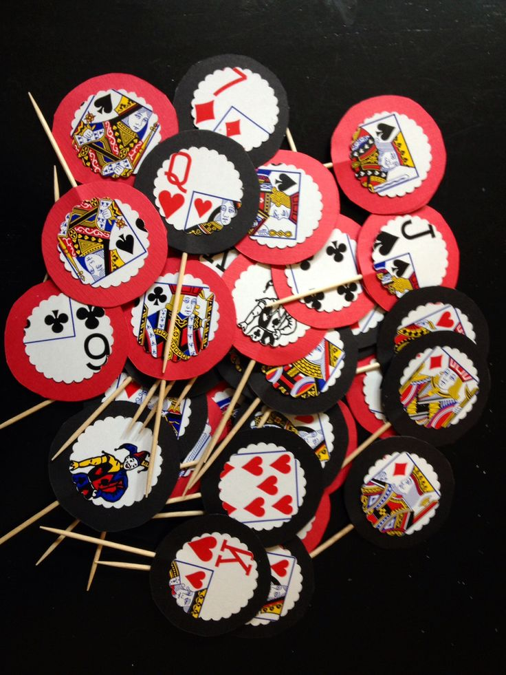 DIY Cupcake Toppers for a Casino/Poker party. Just punched out the playing cards and glued them on red and black circles. Then glued them onto a toothpick!