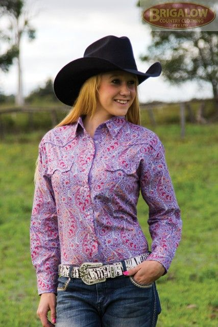 http://brigalowcountry.com.au/girls-western-shirt-marulan-mauve-4052d.htmlThis 100% cotton, rich purple coloured paisley girls shirt features a prominent yoke as well as red highlights. Brigalow's regular western cut has longer shirt tails and sleeves to accommodate more comfortable riding, and are built sturdy and tough to survive the rigours of an outdoors lifestyle.