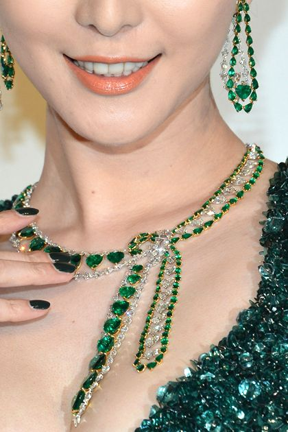 """Fan Bingbing attends the Trophée Chopard Party in an Elie Saab gown paired with a Salvatore Ferragamo clutch. Chopard diamond and emerald earrings and necklace from the """"Red Carpet Collection."""""""