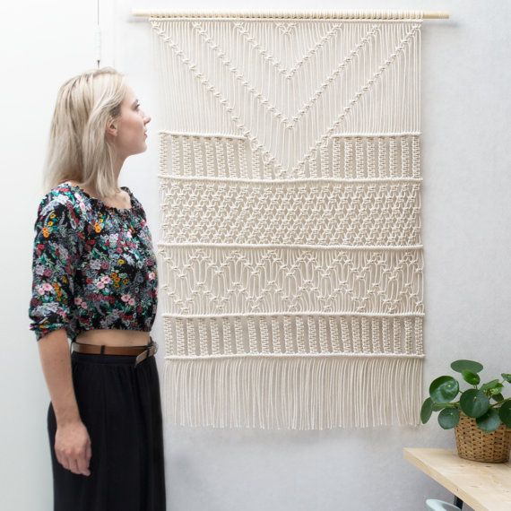 This gorgeous handmade macrame wall hanging is made with neutral cotton macrame…