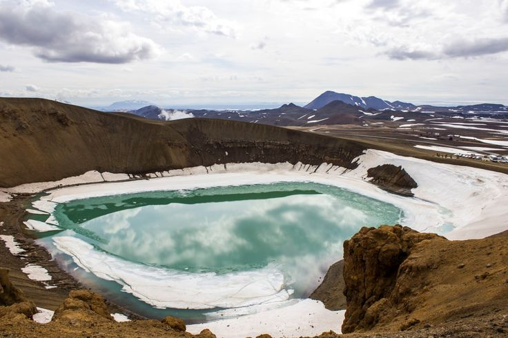 Krafla is a caldera, a cauldron-like depression in the earth following eruptions. At Krafla, there's a Viti crater with a surreal green-blue lake inside it.