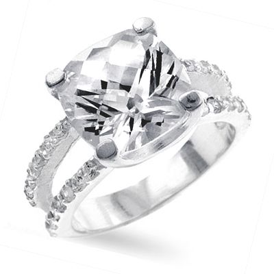 i want this ring! i am madly and completely in love with square cut diamonds!