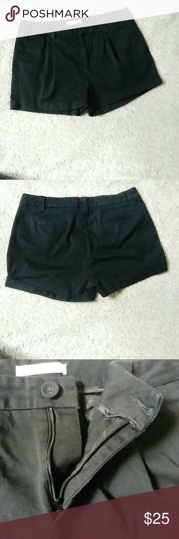 """French Connection black cuffed casual shorts UK Style French Connection black cuffed casual shorts. Size 12. No rips or stains. Zipper fly with button closure. 2 pockets in front. The 2 in back are fake. Waist is approximately 17.5"""" inseam is approximately 2.5"""" cuff on bottom is approximately 1.5"""" rise is approximately 8"""" leg opening is approximately 11"""" French Connection Shorts"""