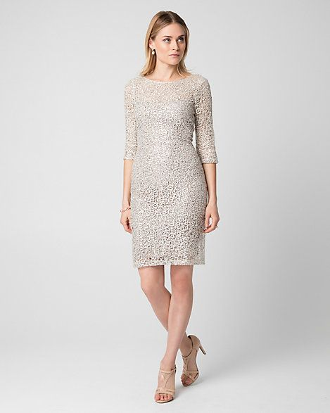 Guipure Lace Illusion Cocktail Dress - An illusion neckline and 3/4 sleeves heighten the romance of a guipure lace cocktail dress finished with a fitted silhouette.