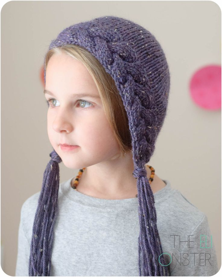 The Flette Bonnet is a uniquely shaped bonnet that features a face framing braid and a creatively shaped back.  The braid cable work adds thickness and warms over your ears and the back is worked in the round for a nice snug fit to keep the wind off. Add tassels to finish off the bonnet.