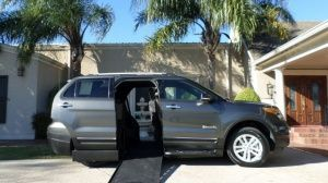 New Wheelchair Van For Sale: 2015 Ford Explorer LT Wheelchair Accessible Van For Sale with a BraunAbility MXV on it. VIN: 1FM5K7D88FGC52616