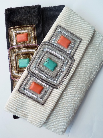 """These evening bags are the perfect essential for a black tie affair, or to make an impact statement in sandals and jeans.   We've shot them in Natural sunlight to show their subtlety. The bags have magnetic snaps and a chain inside. PLEASE SPECIFY BLACK OR IVORY. It's so hard to find the perfect bag to wear to all your formal affairs, unless you have this bag - problem solved for life!9"""" x 6"""""""