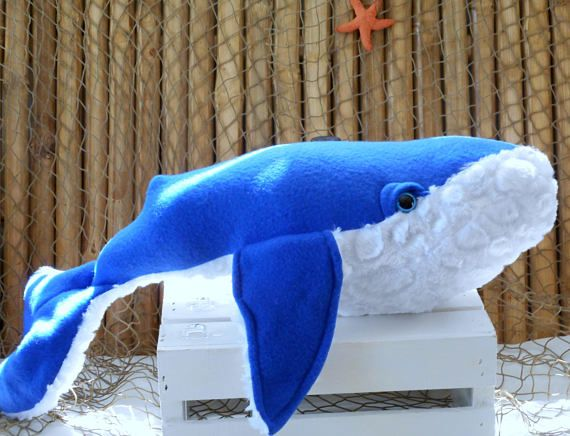 Big whale plushie measures 27 inches long and 7 inches in height. Taken from a wonderful pattern by Crafty Kooka , this whale is made from a blue colored fleece fabric to make it extra soft and cuddly. Its belly is a white minky cuddle stone fabric which mimics the barnacles found on